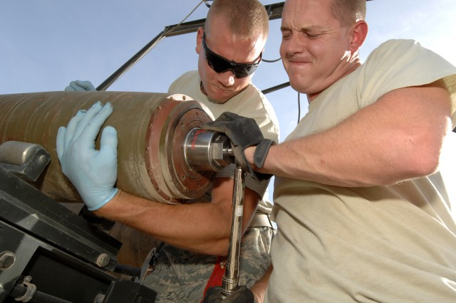 KANDAHAR AIRFIELD, Afghanistan-U.S. Air Force Senior Airman Kyle Detwiler, left, and Staff Sgt. Howard Holland, both from the 23rd Equipment Maintenance Squadron, Moody Air Force Base, Ga., torque down the tail fuse of a Mark 82 General Purpose bomb, using a torque wrench, at Kandahar Airfield, Afghanistan, April 27, 2011. Airman Detwiler and Sgt. Holland are munitions system specialists deployed to the 451st Equipment Maintenance Squadron. (U.S. Air Force photo/Staff Sgt. Stephen D. Schester, 16th Mobile Public Affairs Detachment)