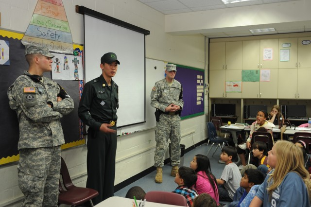 Sgt. Eric M. Horvath, Cpl. Jeong Byung-seok and Pfc. Corey R. Lundgren hold a briefing on the Joint Security Area at Seoul American Elementary School April 27.