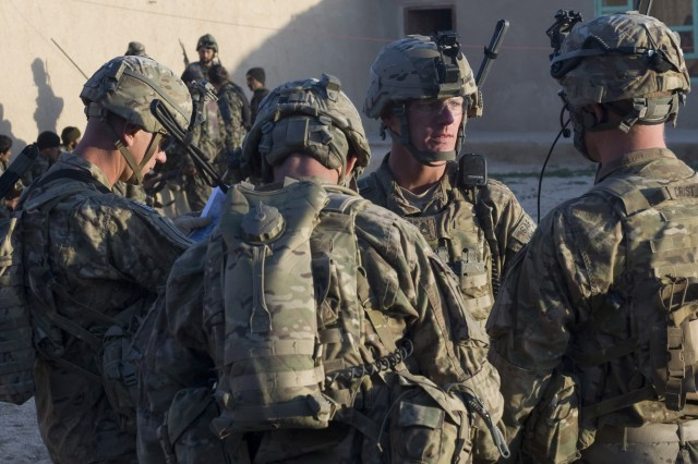 """GHAZNI PROVINCE, AFGHANISTAN (21 April 2011) U.S. Army Sgt. 1st Class James Hawkins, platoon sergeant of 1st Plt., Company D, 2nd Battalion, 2nd Infantry Regiment, 3rd Brigade, 1st Infantry Division, from Lafayette, Ind., briefs his squad leaders on what he expects from them on upcoming patrols in Andar, Afghanistan, on Apr. 21. Hawkins used numerous short patrols to further develop his squad leaders; each one had to develop a plan for patrol and have it approved before setting out on mission. (U.S. Army photo by Staff Sgt. Andrew Guffey 210th MPAD)"""""""