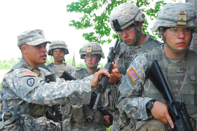 Staff Sgt. David Schible, a drill sergeant with Company D, 1st Battalion, 13th Infantry Regiment, instructs a Soldier in training where to point his weapon as part of a four-man stack during the MOUT testing portion of the Fort Jackson Drill Sergeant of the Year competition Tuesday. The winner will be announced Saturday.