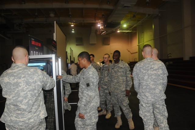 """Soldiers from C Co., 1/64 AR learn about the consequences of drinking and driving through simulation devices at the """"Save a Life"""" tour, April 26 at Fort Stewart's Caro gym. The event was sponsored by Fort Stewart-Hunter Army Substance Abuse Program to discourage Soldiers and Army Civilians from driving while under the influence."""