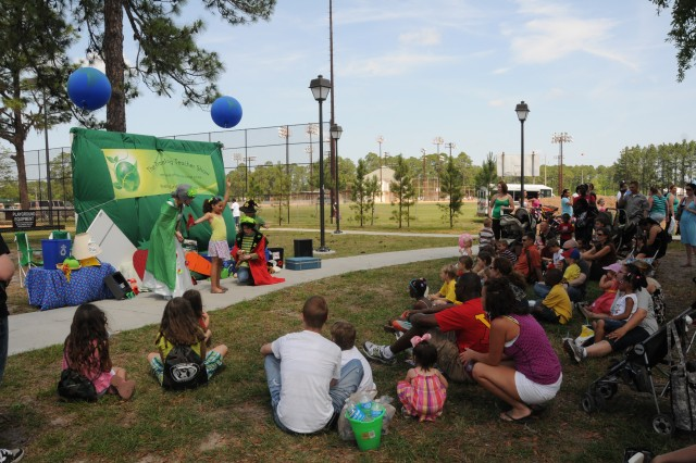 """The """"Traveling Teacher Show"""" performed at Fort Stewart's Annual Easter Egg Hunt and Family Day event, April 23. Their mission is to teach children how to save the earth one child at a time."""