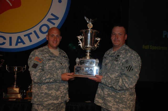 Former commander of the 1st Battalion, 3rd Aviation Regiment, 3rd Combat Aviation Brigade, Lt. Col. Michael Musiol (left), and 1/3 Avn., Command Sgt. Maj. Terry Sparks, pose for a photo after receiving the Army Aviation Association of America's Active Aviation Unit of the Year award, during the 2011 AAAA Annual Professional Forum and Exposition, April 18, at the Gaylord Opryland Convention Center in Nashville, Tenn.