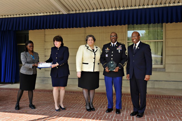 Ms. Seema Salter, deputy assistant Secretary of the Army for Diversity and Leadership; Sgt. 1st Class Bryan K. Harrison, an equal opportunity advisor for 3rd ID, and the Under Secretary of Defense (Personnel and Readiness) Dr. Clifford L. Stanley, pose for a photo at The Pentagon after presenting Sgt. 1st Class Harrison the 2011 Exceptional Sexual Assault Response Coordinator of the Year Award.