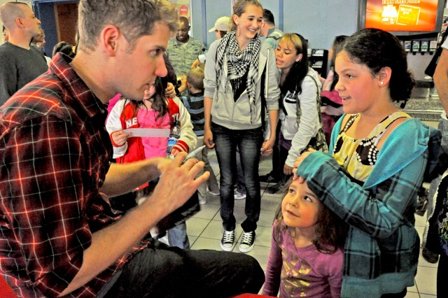 Illusionist Rob Lake signs autographs after a performance in Wiesbaden, Germany.