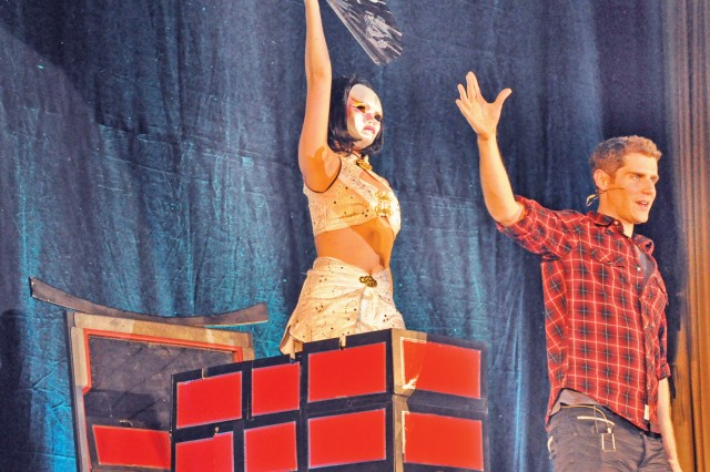 Illusionist Rob Lake performs his Mystery of the Oragami illusion during a free Armed Forces Entertainment show in Wiesbaden, Germany.