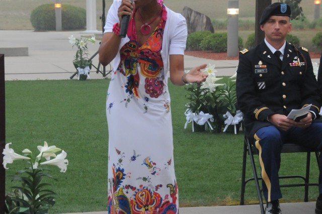 Sergeant Kristina Doolittle, 4-3 BSTB, 3rd ID, sings the special song of the morning for Fort Stewart's Easter Sunrise Service at Marne Garden, April 24.