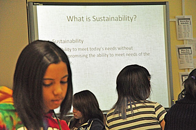Wiesbaden Middle School eight-grader Ashley Barclift takes notes during an Earth Day presentation by sustainable engineering manager Rich Gifaldi with the U.S. Army Corps of Engineers, Europe District.