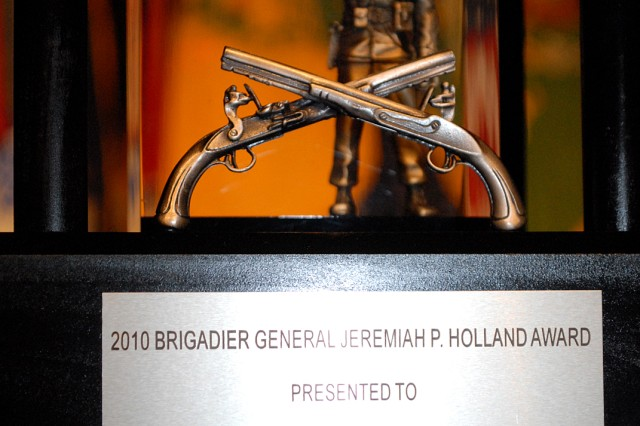 Headquarters and Headquarters Company,705th Military Police Internment and Resettlement Battalion, was presented the Brigadier General J.P. Holland Award during a ceremony honoring the Army's top 2010 military police company April 25 at the Lewis and Clark Center, Fort Leavenworth, Kan.