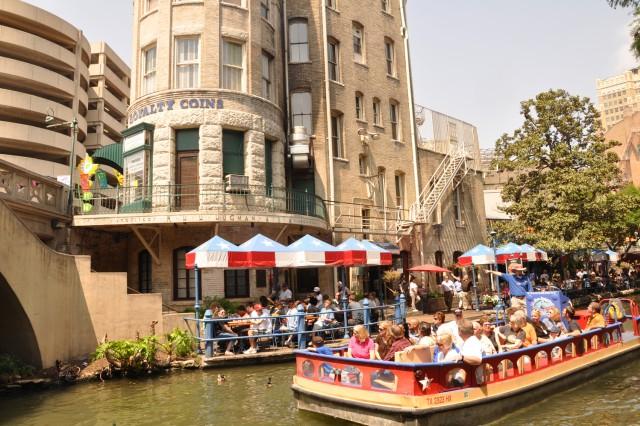 Visitors enjoy a riverboat ride along the River Walk in San Antonio.
