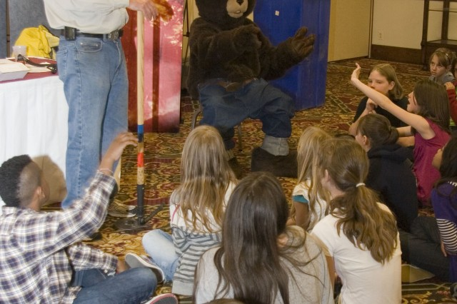 FORT CARSON, Colo. - Students from Mountainside Elementary School learn about fire safety from Smokey the Bear and Dave Root, assistant district forester, during a two-day fair for Earth Day. The fair taught the students about conservation resources on Fort Carson.