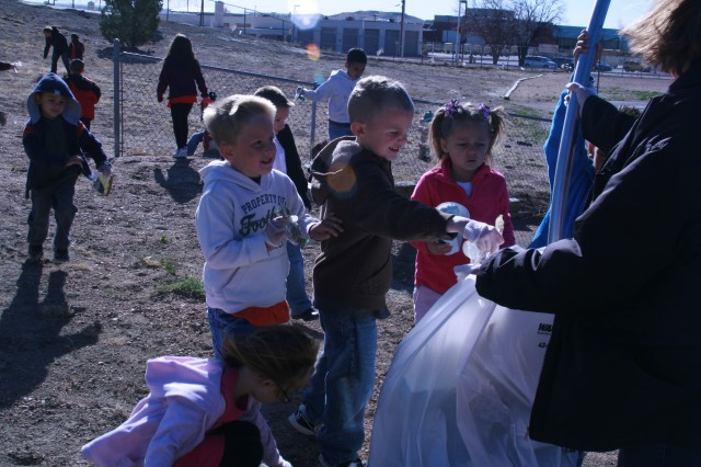 FORT CARSON, Colo. -- Kindergarteners from Abrams Elementary School brave 43 mph winds April 22 to pick up trash as part of Earth Day celebrations.