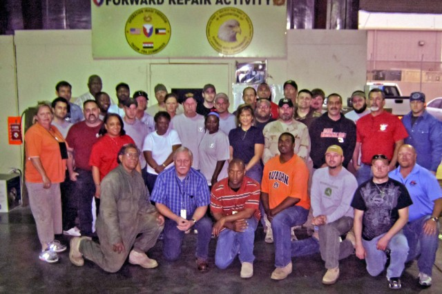 Camp Arifjan, Kuwait, houses both Anniston Army Depot and Red River Army Depot employees. Here, they pose for a group photo.