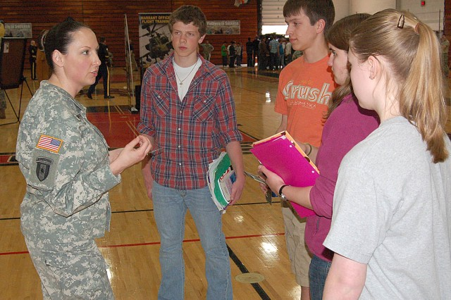 "FOND DU LAC, Wis. -- Staff Sgt. Melissa Murphy, Milwaukee Recruiting Battalion, explains the features of ""March 2 Success,"" a free online exam preparation program, to students at Fond du Lac High School. March 2 Success provides materials to help improve scores on the SAT, ACT, and the Armed Services Vocational Aptitude Battery."