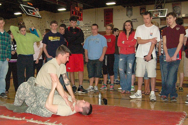 STEVENS POINT, Wis. -- Staff Sgt. Aaron Green and Sgt. Adam Streblow, Milwaukee Recruiting Battalion, demonstrate self-defense techniques during Pathway to Success at Stevens Point Area Senior High School on Wednesday, April 13.
