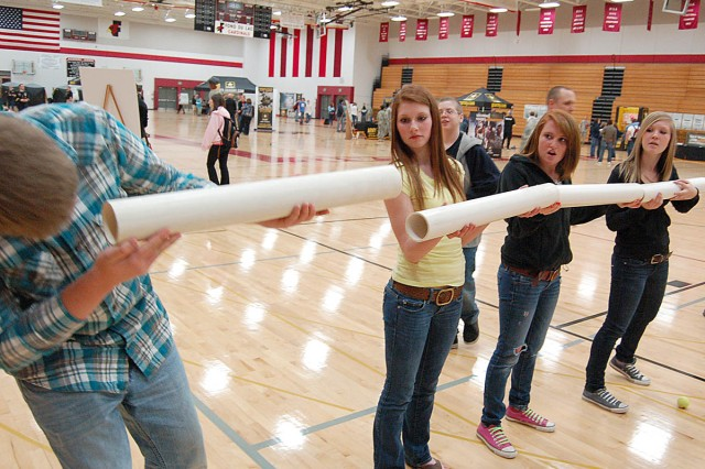 FOND DU LAC, Wis. -- Students coordinate to move a tennis ball through tubes without dropping it during Pathway to Success at Fond du Lac High School April 15.