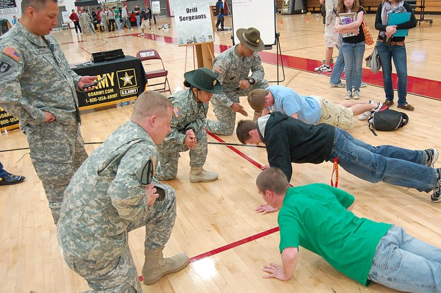 FOND DU LAC, Wis. -- Recruiters and drill sergeants challenge Fond du Lac High School students to do as many push-ups as possible within 60 seconds during Pathway to Success, a fitness promotion run by the Milwaukee Recruiting Battalion April 15.