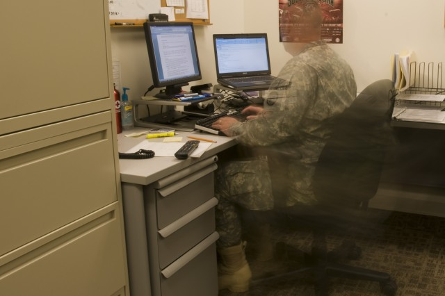 Maj. William Rhoden works to gather vital information from the Army Reserve's operation force after tornadoes and extreme weather destroyed communities and uprooted lives across the South early Thursday morning. Rhoden is the 81st Regional Support Command's emergency operation center's officer-in-charge. Rhoden and other Soldiers and civilians worked to support more than 45,000 Reserve Soldiers across nine states and Puerto Rico as treacherous storms hovered over the command headquarters building at Fort Jackson, S.C.