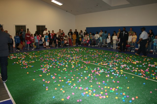 Children line up in the Potomac Place Neighborhood Gym, ready to begin their hunt for hidden prize eggs. This year, Picerne held the egg hunt indoors due to a rainy Saturday.