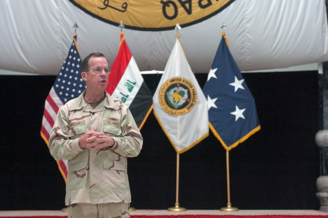 U.S. Navy Adm. Mike Mullen, chairman of the Joint Chiefs of Staff, speaks to service members during an all-hands call on Camp Victory, Iraq, April 22. The gathering included an awards ceremony, a reenlistment ceremony, as well as a question and answer session between Mullen and the service members.