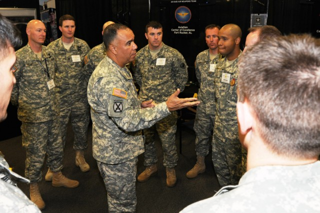 Maj. Gen. Anthony G. Crutchfield, USAACE and Fort Rucker commanding general, thanks Soldiers who were demonstrating the ALC 2015 training concept at the USAACE booth during the Army Aviation Association of America professional forum in Nashville, Tenn., April 18-21.