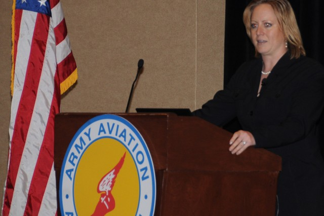 Nicolette Maroulis, wounded veteran athlete, speaks to Aviation spouses about resiliency during the Army Aviation Association of America professional forum in Nashville, Tenn., April 18-21.