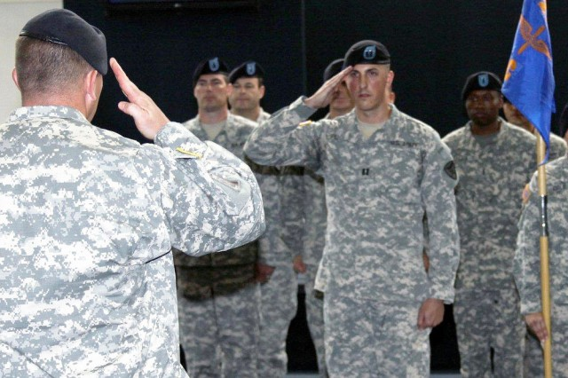 "Capt. John A. Plitsch salutes Lt. Col. Michael Burns, 1st Bn., 212th Avn. Regt. commander, during the activation ceremony of C. Co. ""Nighthawks"" of the 1st Bn., 212th Avn. Regt. April 20."