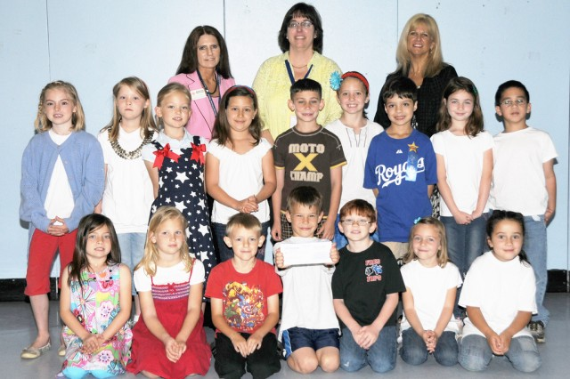 Kindergarten and first grade students at Fort Rucker Primary School were presented a check for $1,100 by the Red Cross for the money they raised for the Japan earthquake and tsunami victims.