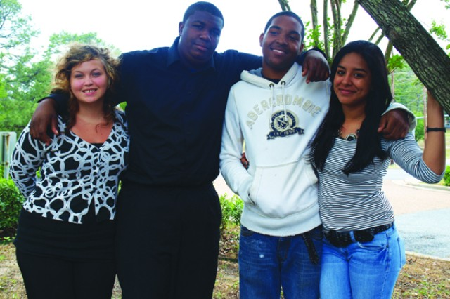 Four teens from Fort Polk's Child Youth and School Services Youth Hire Program bond, laugh and write poetry together; a fiercely independent bunch, they are the embodiment of the resiliency being a military dependent fosters. From left, Diane Tucker, Justin Williams, Chris Jackson II and Jocelyn Macias enjoy each other's company a spring day.