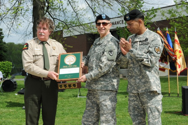 Wayne Merkel, representing the Maryland Department of Natural Resources, presents Maj. Nick Justice, senior installation commander, and Col. Orlando Ortiz, APG garrison commander, with the Tree City U.S.A. award from the National Arbor Day Foundation and the U.S. Department of Agriculture Forest Service.