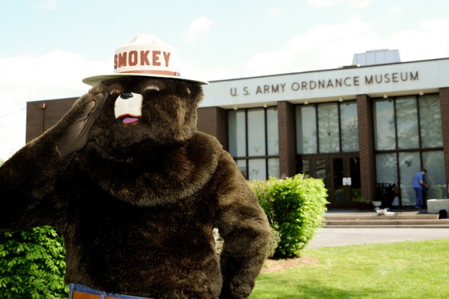 Smokey the Bear salutes attendees at Aberdeen Proving Ground's Earth/Arbor Day celebration April 29.