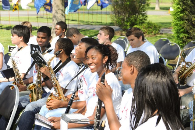 Musicians from the Edgewood High School Band relax before the start of APG's Arbor/Earth Day celebration April 29.