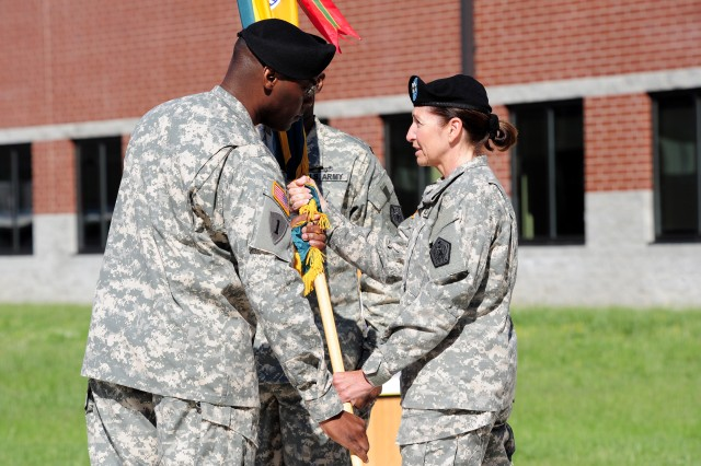 Incoming U.S. Army Human Resources Command (HRC) Command Sgt. Maj. Bruce A. Lee accepts the colors from HRC commander Maj. Gen. Gina S. Farrisee during the U.S. Army Human Resources Command Change of Responsibility today at the Lt. Gen. Timothy J. MaudeComplex at Fort Knox.