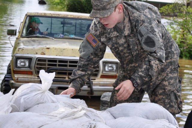 Kentucky Guardsman Pvt. Jeremy Long, 2113th Transportation Company, delivers sandbags to local residents for flood relief missions in Oscar, Ky., April 27, 2011.