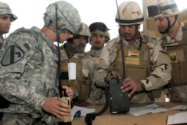 NCOs mentoring Iraqi soldiers