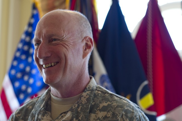 Gen. Robert W. Cone, incoming commanding general of U.S. Army Training and Doctrine Command, is promoted according to congressional approval and assumes command of TRADOC on April 29, 2011, on Fort Monroe, Va. Gen. Martin E. Dempsey, Chief of Staff of the Army, and Jill Cone, Cone's wife, participate in the ceremonies. Commanders of TRADOC's subordinate units and their colors attend the ceremony of assumption of command. (U.S. Army photo by Sgt. Angelica Golindano)(RELEASED)
