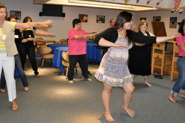 SiAna Camacho teaches Fort Irwin Women's Conference participants how to hula dance during the conference April 28 at Reggie's.
