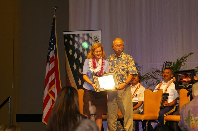 Helen Gibson Ahn receives the Federal Employee of the Year in the Exceptional Community Service category during the 55th Annual Excellence in Federal Government Awards ceremony held in Honolulu, HI, April 21.