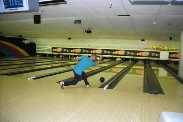 """FORT SHAFTER, Hawaii - Pfc. Johnny Robertson, Network Enterprise Center, 30th Signal Battalion, 516th Sig. Brigade, 311th Sig. Command, bowls at the """"Strike Out Sexual Assault"""" event at the Bowling Center, here, April 21."""