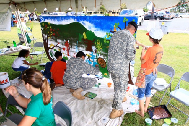SCHOFIELD BARRACKS, Hawaii - Creating murals celebrating the International Year of Forests was one of the activities at the 4th Annual Earth Day Festival, held April 20, here.