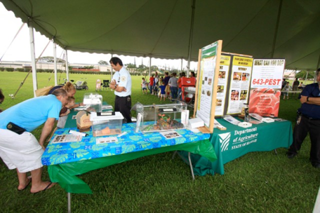 SCHOFIELD BARRACKS, Hawaii - Creeping, crawling and slithering creatures draw festival-goers to the Hawaii Department of Agriculture exhibit that showcased several invasive species at the 4th Annual Earth Day Festival, held April 20, here.