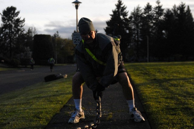 Command Sgt. Maj. Dwight Altheide, representing the 16th Combat Aviation Brigade, swings a 125-pound wrecking chain during the Physically Mentally Emotionally Hard Gauntlet April 29, 2011, at Joint Base Lewis-McChord. The PME Hard Gauntlet was held by I Corps Command Sgt. Maj. John Troxell to show senior leaders how to engage various muscle groups with non-standard equipment, using a combat-focused plan.