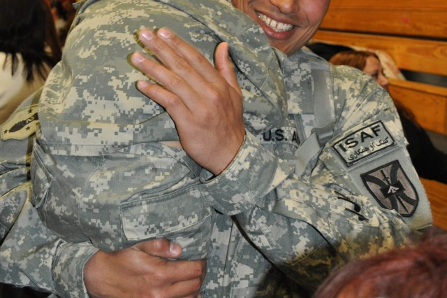 Sgt. Ramon Troya holds his son, Jaden, 3, during the homecoming ceremony for the 557th Maintenance Company on April 30, 2011 at Fort Irwin, Calif. The 557th Maintenance Company completed a yearlong deployment to Afghanistan on April 30, 2011.