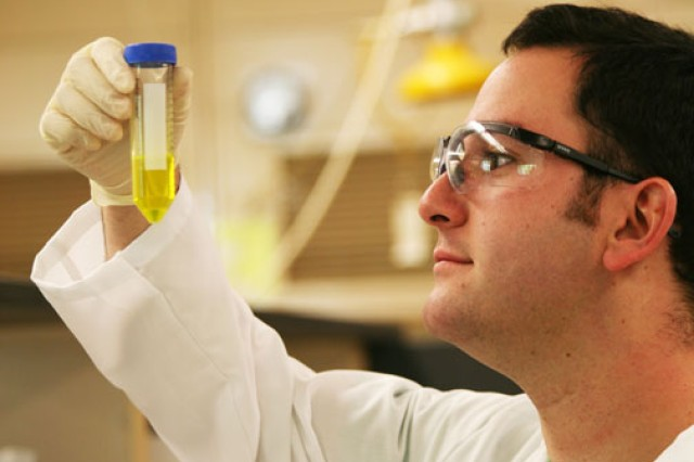 Dr. Thomas Morrow works on the fabrication of curcumin therapy (TyroMatTM) to promote healing and reduce scarring.