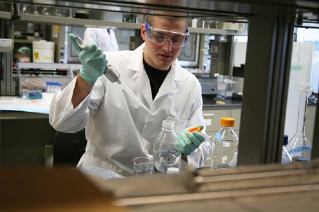 Researcher Anthony Radice works at the lab bench.