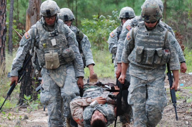 Soldier medics learn how to use various types of patient litters, such as the SKED, to transport patients.