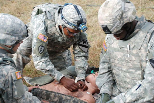 Soldier medics practice techniques to re-inflate a collapsed lung. Tension pneumothorax is second only to hemorrhage as the most common cause of preventable death on the battlefield.