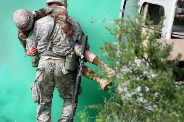 "A Soldier medic evacuates a ""wounded"" comrade during patrol operations training at the Camp Bullis Training Site in San Antonio."