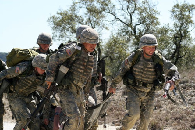 Soldier medics evacuate a patient from a casualty collection point during patrol operations training at the Camp Bullis Training Site in San Antonio.