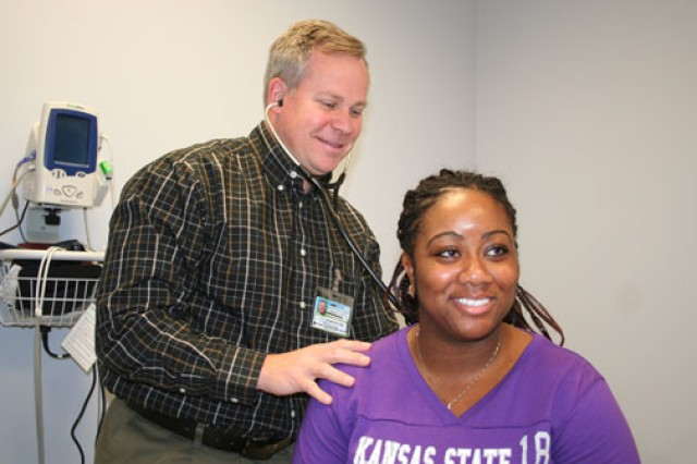 Dr. Mark Trawinski, Screaming Eagle Medical Home medical director at Fort Campbell, Ky., provides care to Patrice Hergert.